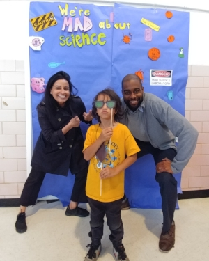 Dr. Sweta Batni and Dr. Christopher Williams pose with a student at Bancroft Science Night.