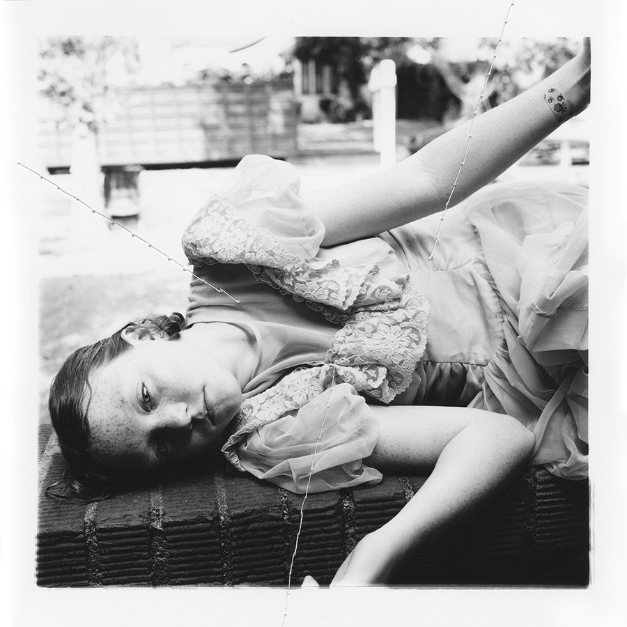 "ruptured ""girls at eleven"" no. 26 Material: Silver gelatin print, linen thread 11"" x 14"" 1998/ 2014"