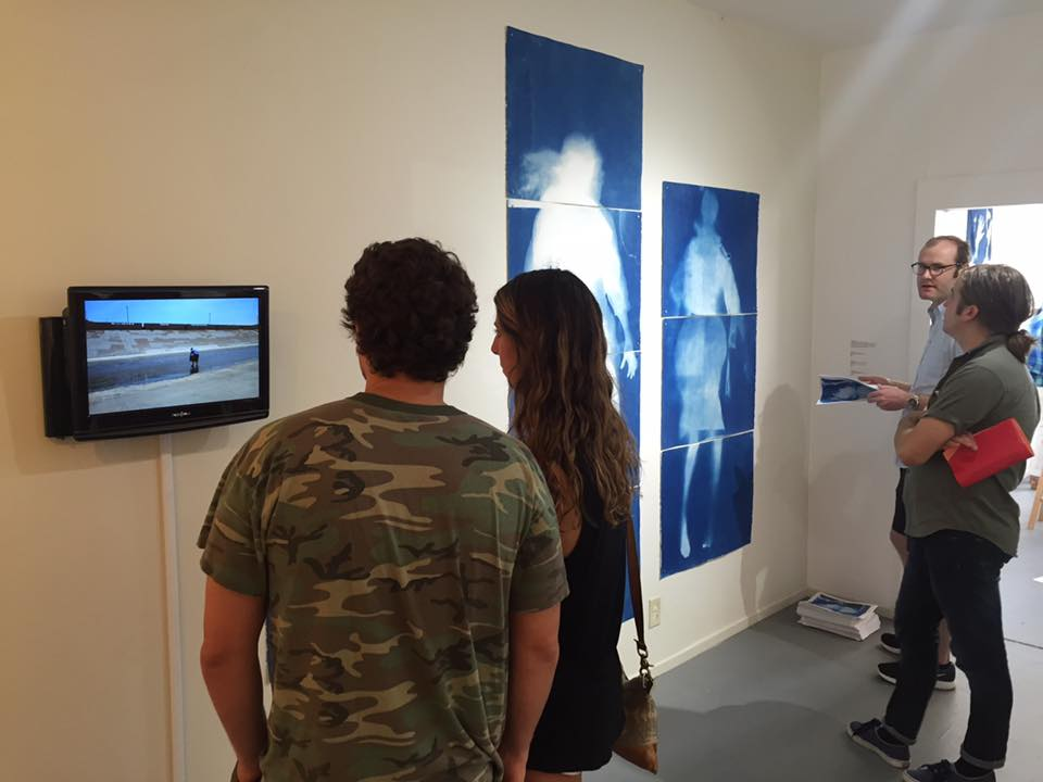 """Coming to Table"" installation shot of Madison THIRST cyanotypes and Abeles's video, AGCC, June 2016"