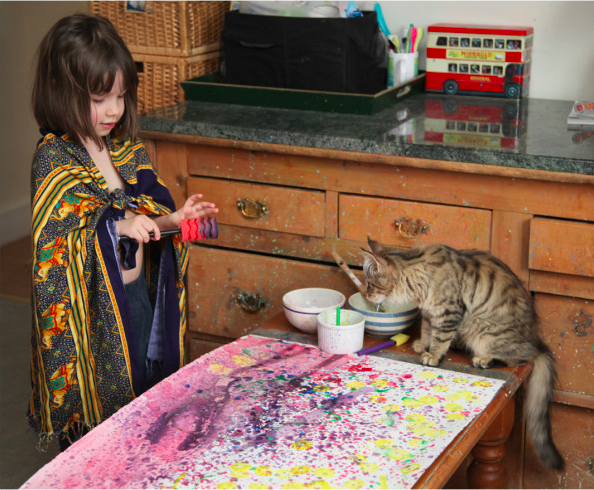 Iris Grace painting with her cat