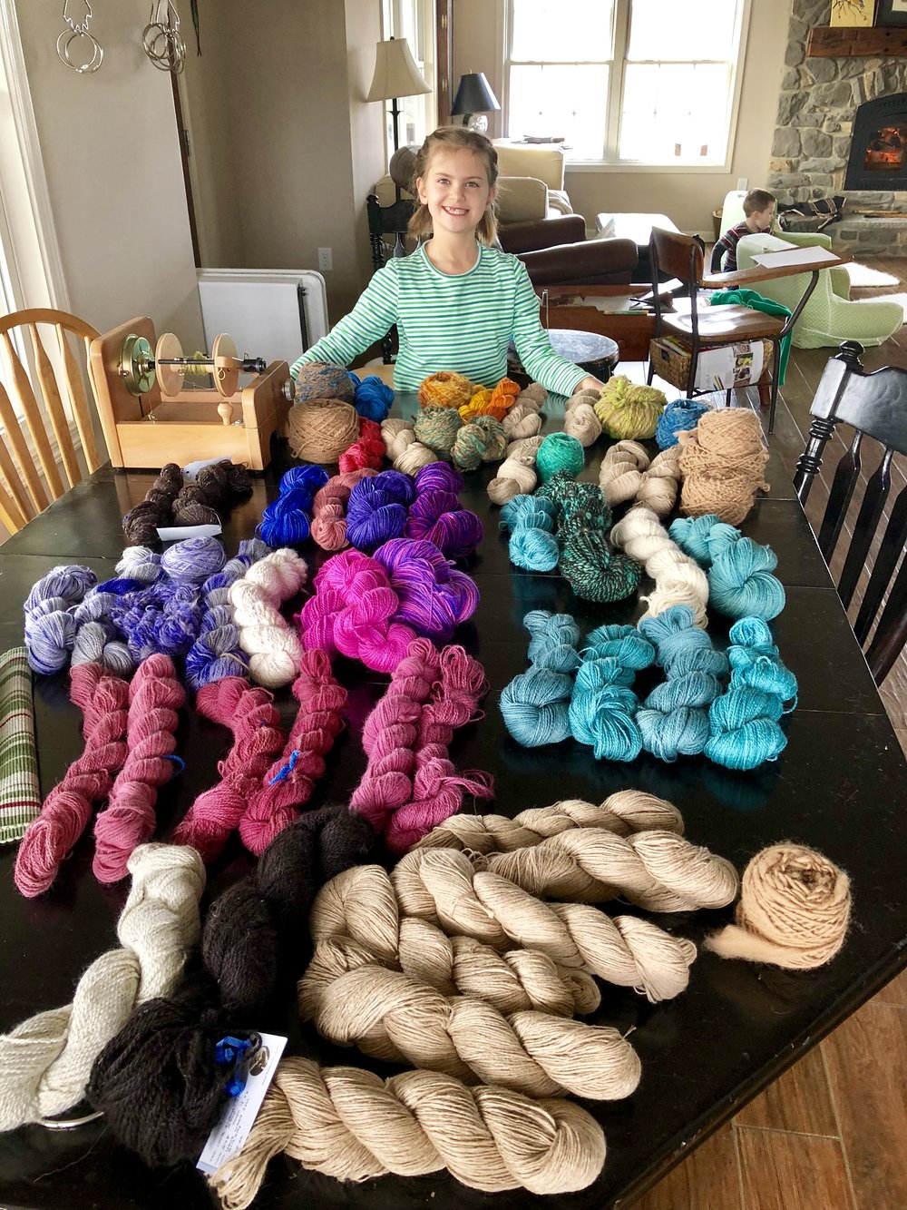 Aidyn helping me decide which yarn to take to Korea to weave with.