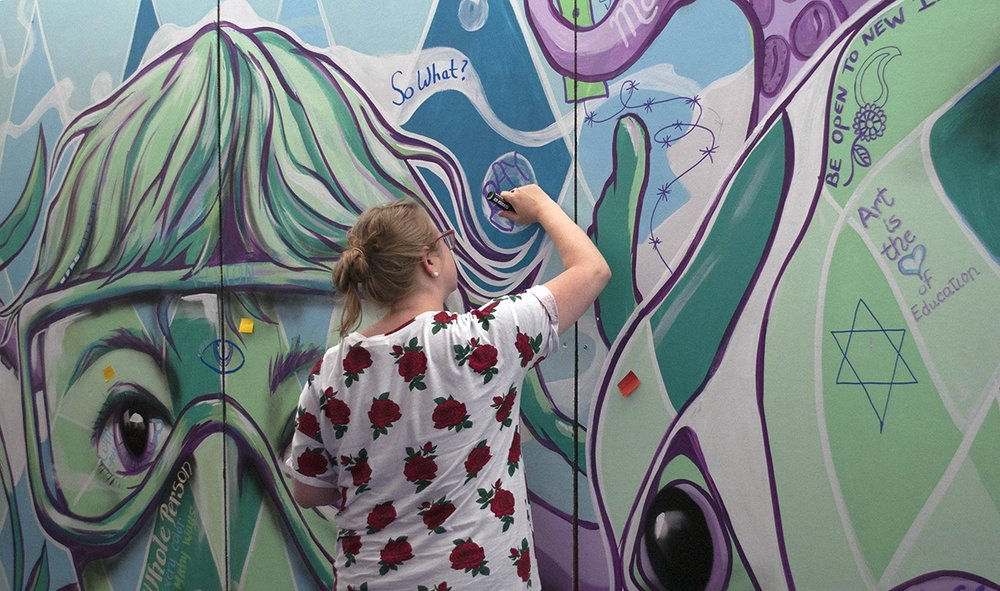 Everyone was invited to reflect on their experience and add to a colorful collaborative mural.