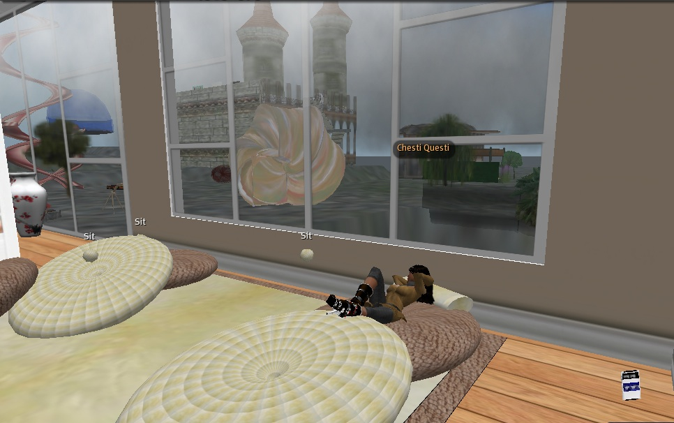 Chesti Questi listening to Howard Stern in her living room–her favorite thing to do in Second Life
