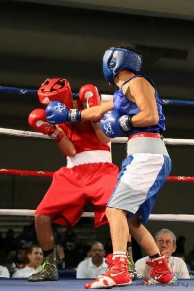 "Portland Boxing Club's Gabriel ""Tito"" Morales (right/blue trunks) of Portland, ME and Jason Meza of National City, CA (left/red trunks).  Photo courtesy of Kineo Photography."
