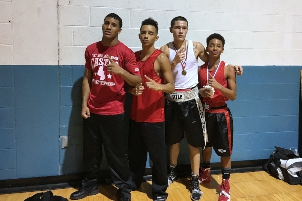 Portland Boxing Club boxers shown here with another Maine boxer from Lewiston, Isaac Escobar, who also scored a victory (left to right: Josniel Castro, Gabriel Morales, Isaac Escobar, and Barry Wilson). Photo credit: Kineo Photography.