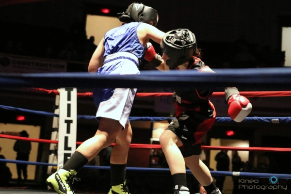 Portland Boxing Club's Kate Zehr (right) at the New England Golden Gloves novice semi-finals in Lowell, MA. Photo courtesy of Kineo Photography.