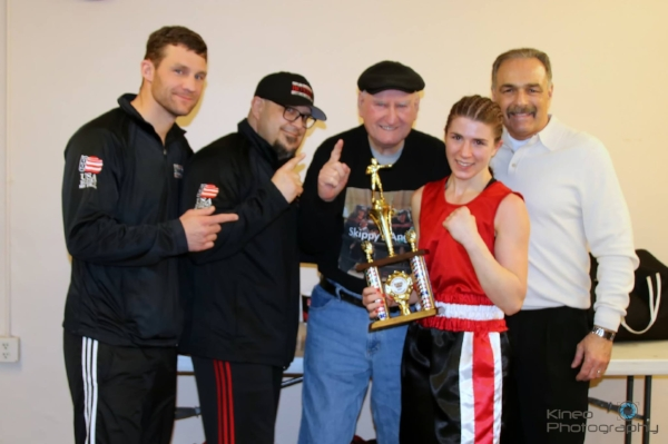 Kate Zehr along with her Portland Boxing Club Coaches, from left to right: Ivan Papkee who assisted Kate in the corner, Coach Jack Lumus, Coach Skip Neals, Kate Zehr and Head Coach Bobby Russo. Photo courtesy Kineo Photography.