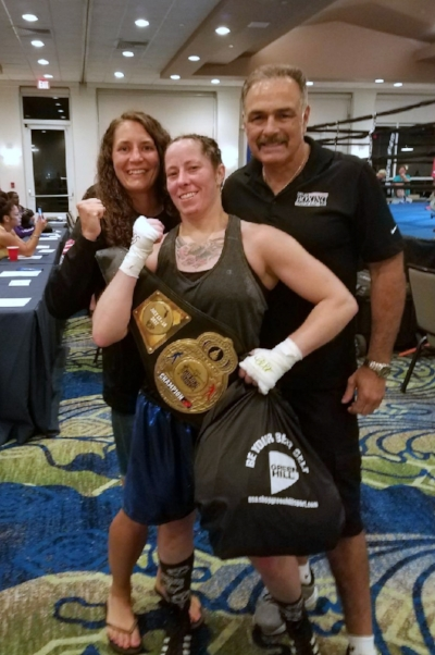 Portland Boxing Club's Lindsday (Kyajohnian) Francois (left) who won bronze and Liz Leddy (center) who won gold along with head coach Bobby Russo (right) at the 18th Annual Women's National Golden Gloves in Fort Lauderdale, FL.