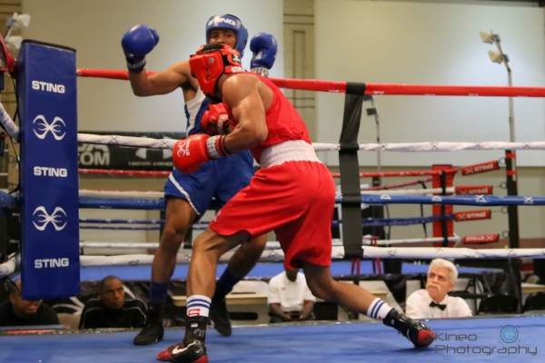Portland Boxing Club's Josniel Castro (red trunks) at the USA Boxing Elite Qualifiers in Chattanooga, TN.  Photo courtesy Kineo Photography.