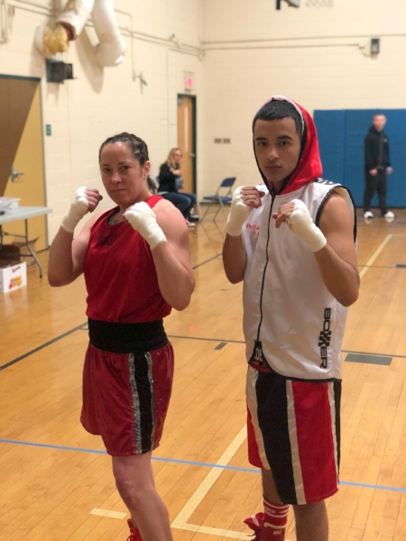 Portland Boxing Club's Liz Leddy (left) and Tito Morales (right) at Fight for Youth II in Haverhill, MA on June 23, 2018.