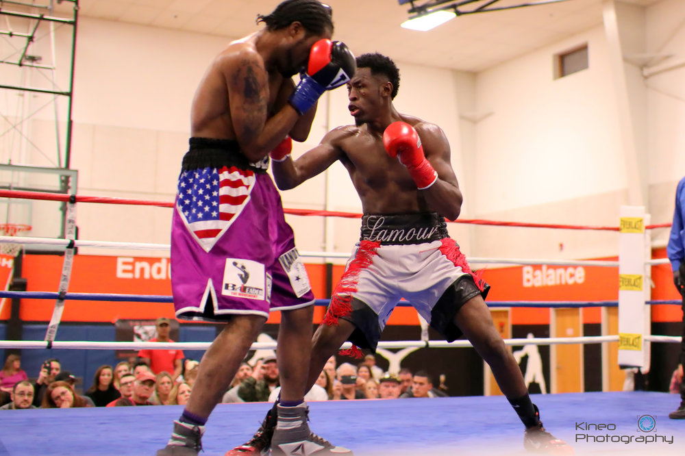 "Portland Boxing Club's pro middleweight Russell ""The Haitian Sensation"" Lamour, Jr. (right) at the Skowhegan Pro-Am event on December 1, 2018.  Photo courtesy Kineo Photography."