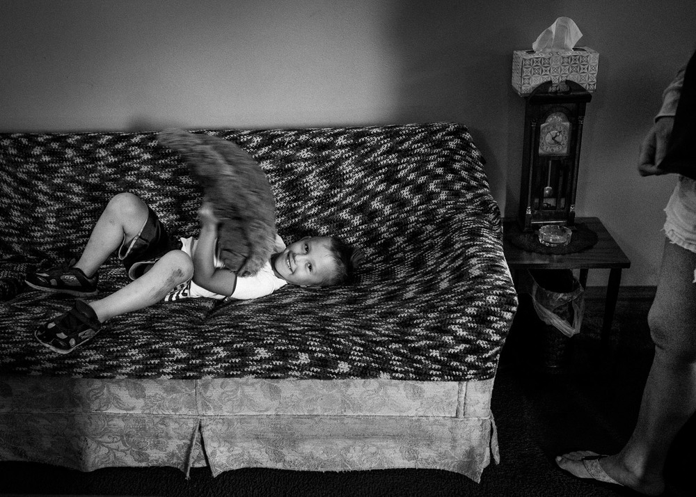 boy on sofa at home