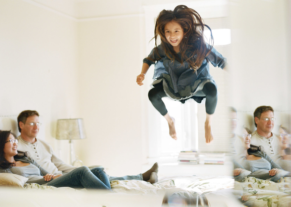 girl_jumping_on_bed.jpg
