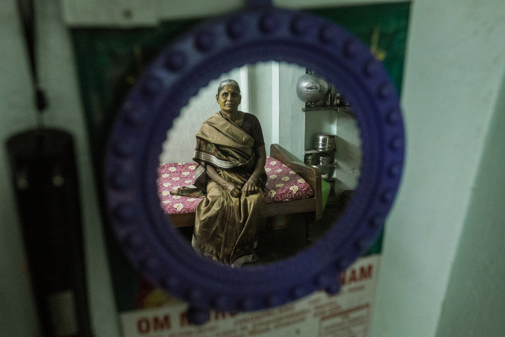 woman reflected in mirror