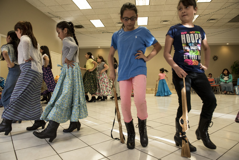 "In preparation for the Cinco de Mayo festival, girls practice the dance of ""La Adelita"" which honors the female soldiers who fought during the Mexican Revolution."