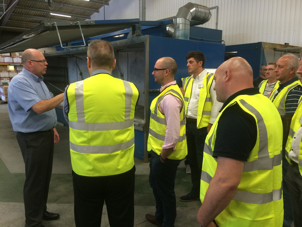 Garry Peake, Manager of Aluroll's Steelroll range, shows visitors the Powder Coating facilities