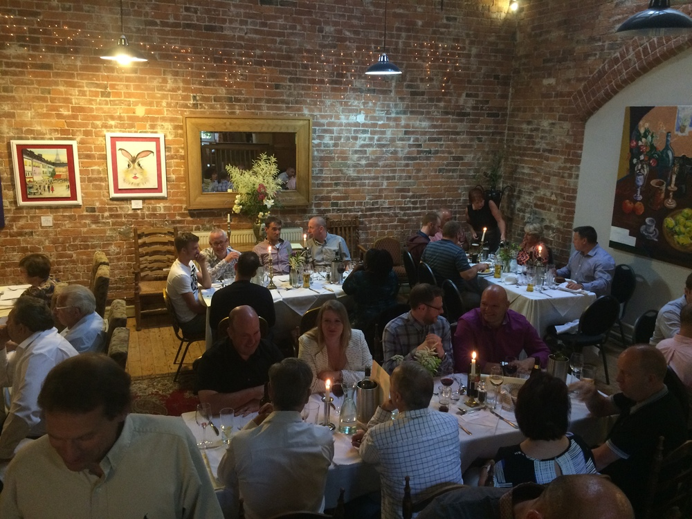 Guests relaxing for dinner and drinks after the Aluroll Showroom Launch