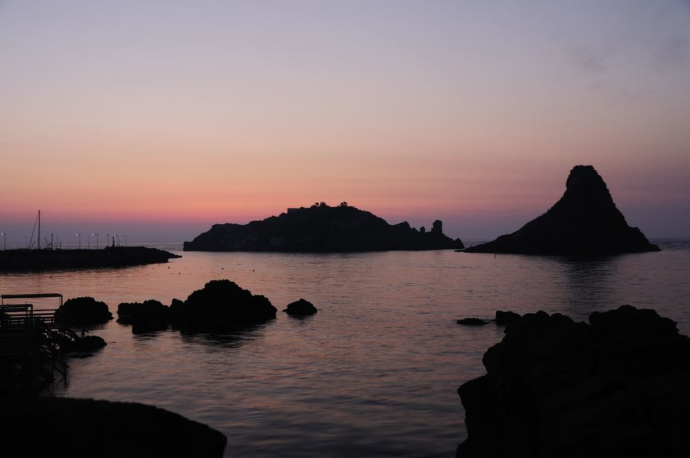 Islands_of_the_Cyclops_at_Dawn_Sicily_Italy_-_Creative_Commons_by_gnuckx.jpg