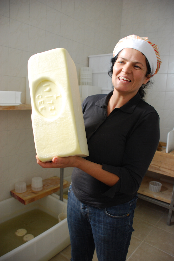 Ornella with one of her DOP cheeses, on our farm visit