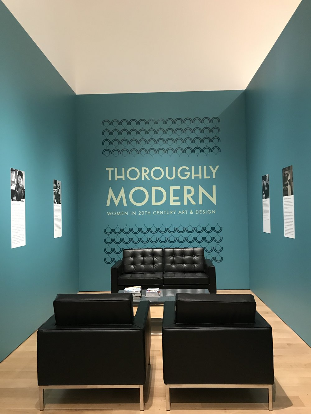 The secondary title wall, visible from other galleries in the museum, repeats the same pattern and type treatment. The pattern draws you into this separate reading space which also features biographical panels about some artists in the exhibition.
