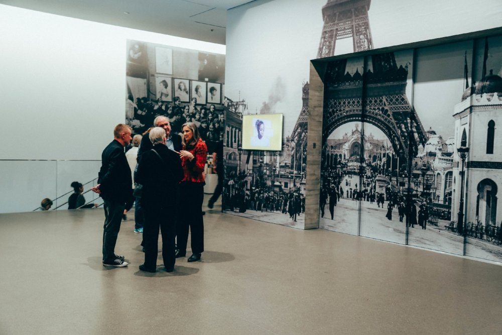 Opposite the elevator door is an image of Paris, creating the feeling of an outdoor space in the lobby area, before you enter the exhibition.  Photo by Rhianna Terrien.