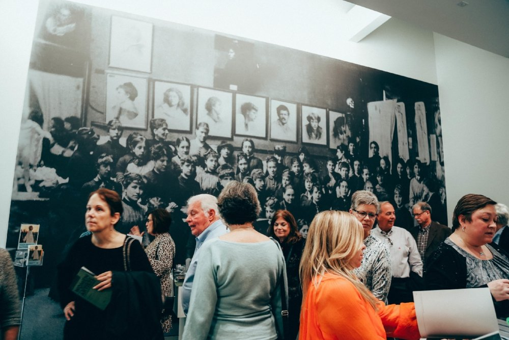 After the exhibition's exit, a large photo of women artists in a studio provided the perfect backdrop for the pop-up store of exhibition merchandise for sale on the weekends.
