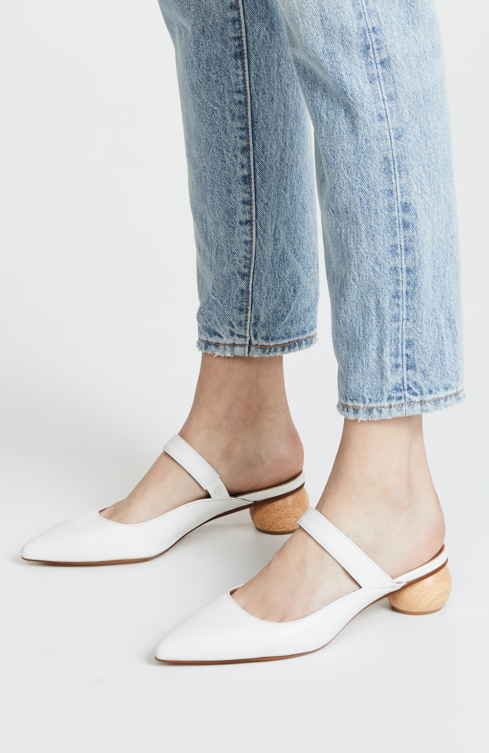 3-white-mules-with-wooden-heel.png