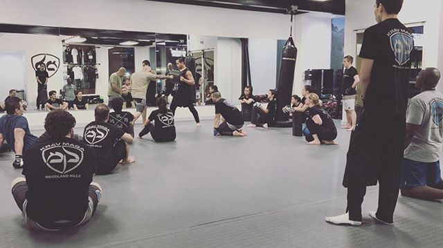 KM Beginners class watching closely as Head Instructor, Chris Gors, demonstrates and explains the importance of a clean, straight, punch. 💥👊🏼💥