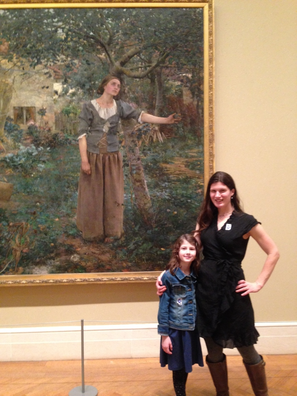 "Here we are, standing in front of ""Joan of Arc,"" a huge painting by Jules Bastien-Lepage (1879).  Nell really liked it."