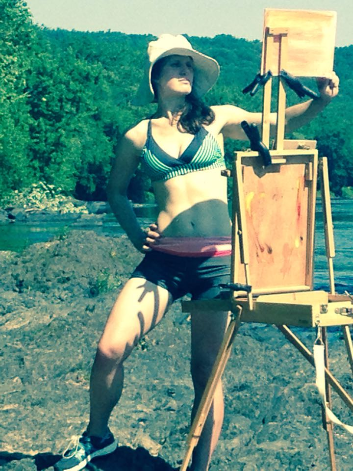 My son took this picture of me painting in my bathing suit.