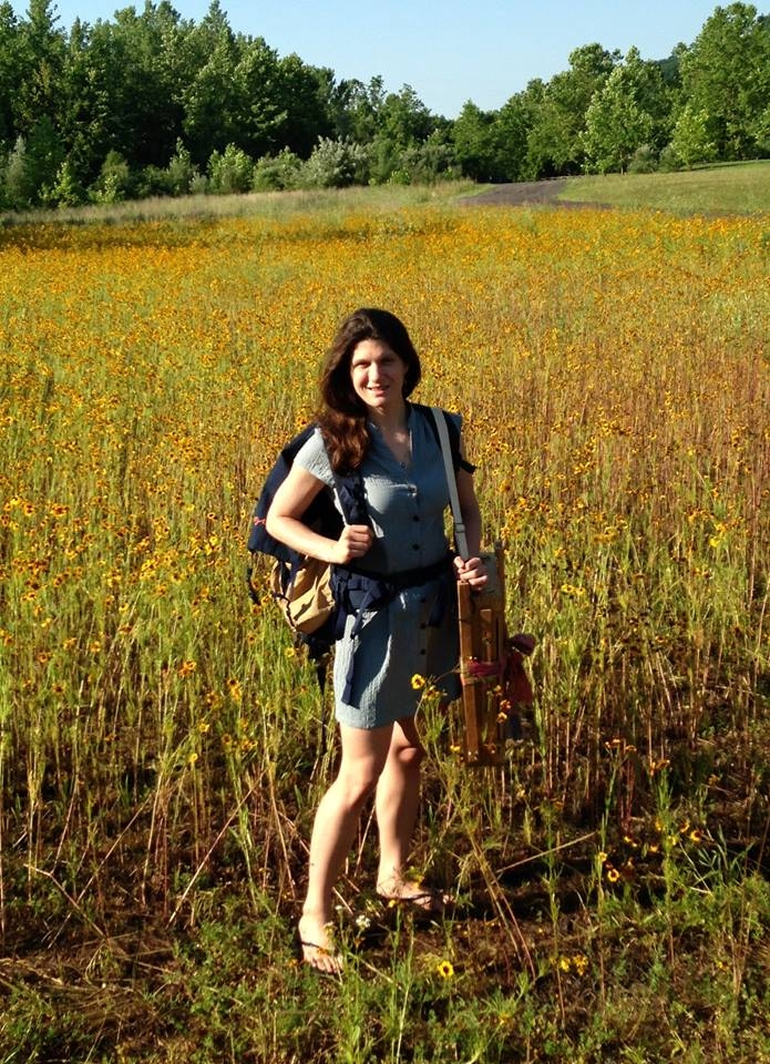 What I did over my summer vacation:  I painted plein air!  Boy, did I paint!  All summer long!    Here I am with my bag of supplies and my bulky french easel and my optimistic attitude, in a field of golden coreopsis flowers!