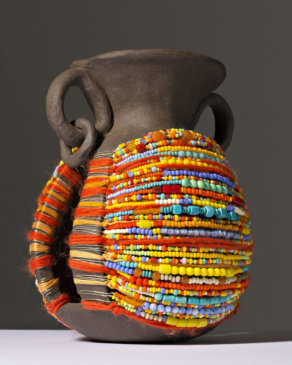 """Adorned Vessel in Yellow"", ceramic, yarn and beads, 2015"