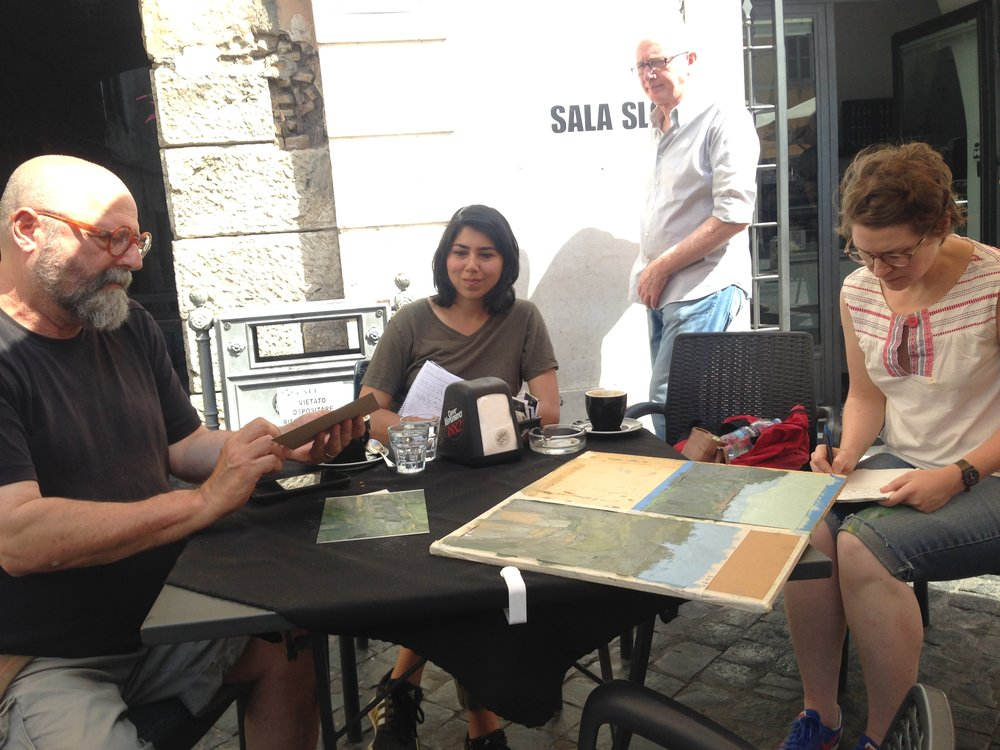 Here is Israel (far left) during a critique, with Marsal in the center, and Christina on the right.