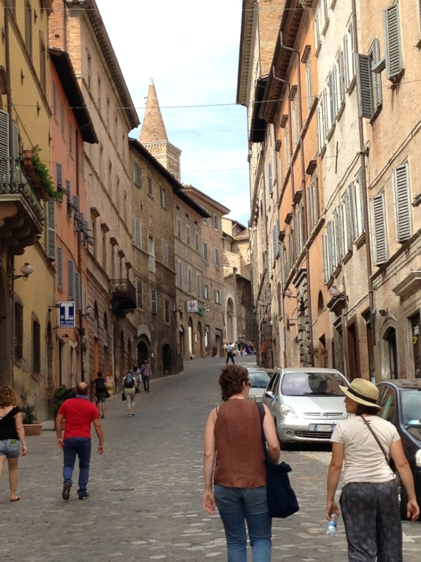 I'm following Christina and Kristen up old cobbled streets in Urbino.