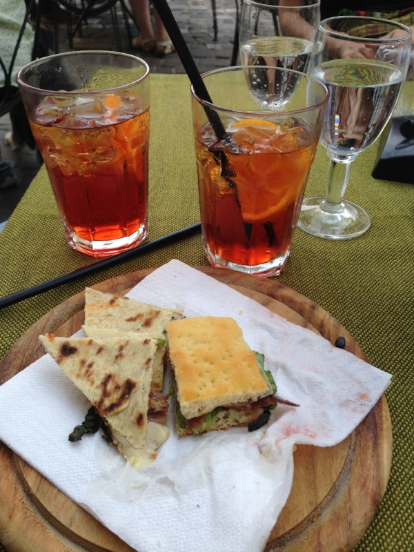 "After leaving the Duke's Palace, I met up with a couple of artist friends and we had a drink (my first negroni! quite memorable) and then we happily wandered up and down the old, twisting alleys.  I wrote a poem about the experience,  ""Drunk in Urbino."""