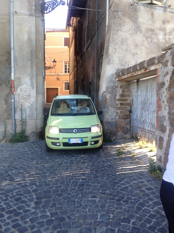 A little car in a little alley!  I saw this sort of thing a lot, and I thought it was so funny!