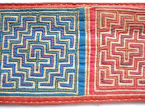 Antique reverse applique panel created by the Hmong People of Southeast Asia.  This was sewn onto traditional clothing.