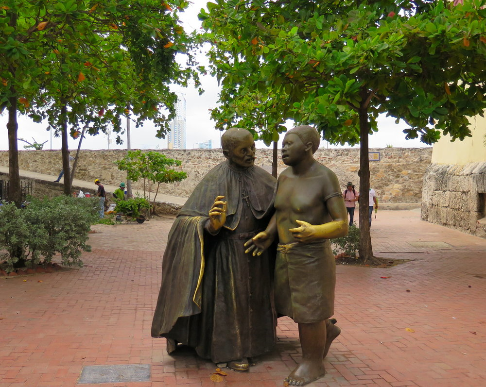 "A statue found in the Walled City celebrating Saint Pedro Claver, a Jesuit Missionary who was called, ""a slave to the slaves."" He worked for more humane conditions, but most of his work's focus was on converting Africans to Catholicism."