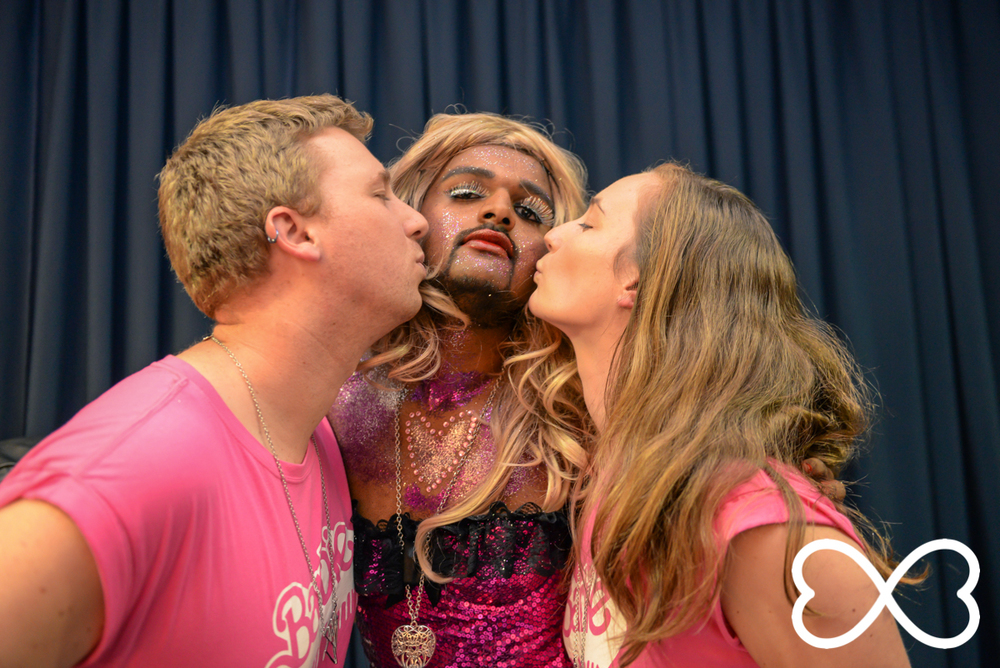 Contestant Sen Raj and back up dancers share a moment backstage at Lip-Sync Duels.  Photograph by Jeffrey Feng Photography for SGLMG.