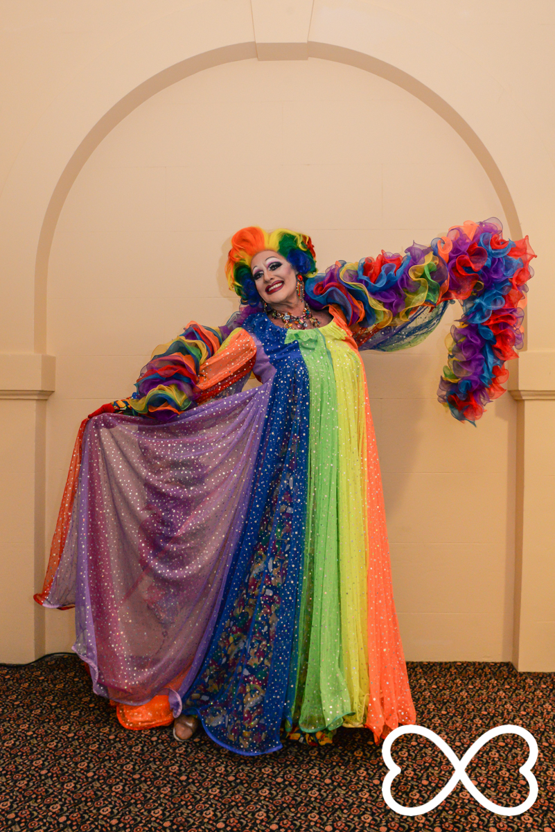 Host Polly Petrie resplendent in rainbow, backstage at Lip-Sync Duels.  Photograph by Jeffrey Feng Photography for SGLMG.