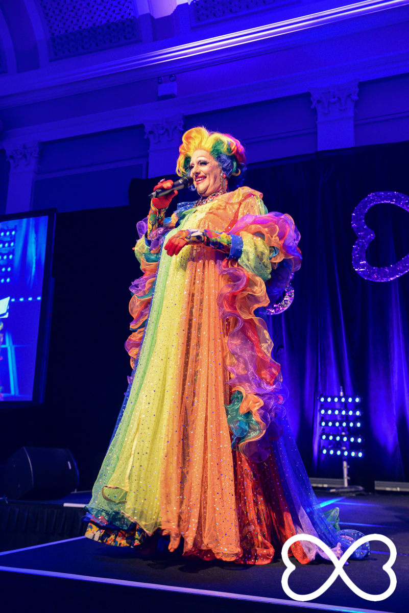 Host Polly Petrie at Lip-Sync Duels.  Photograph by Jeffrey Feng Photography for SGLMG.