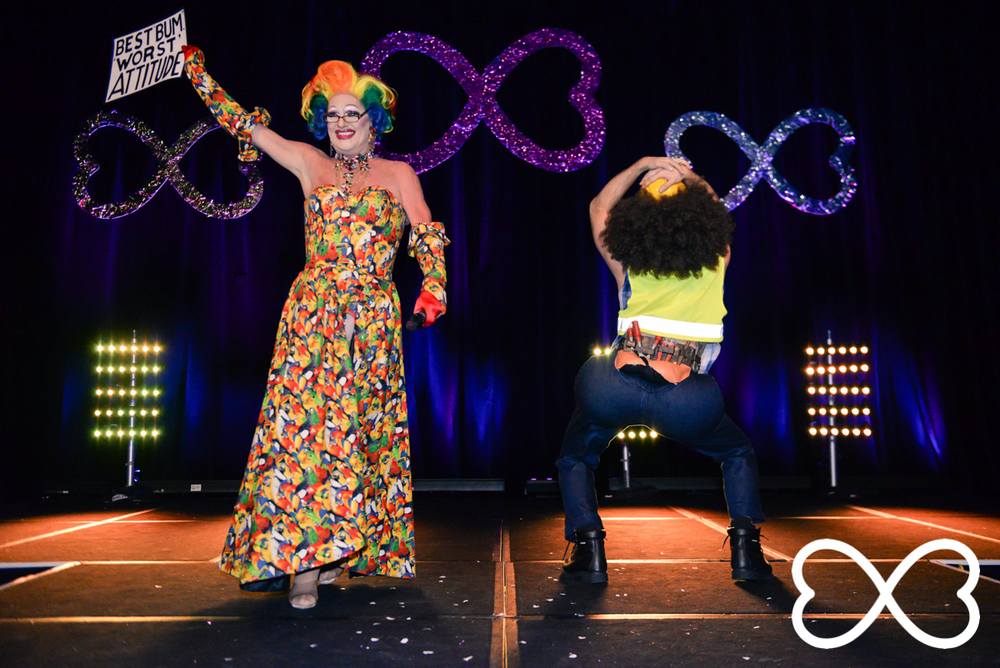 Polly Petrie and Dan Murphy on stage at Lip-Sync Duels.  Photograph by Jeffrey Feng Photography for SGLMG.