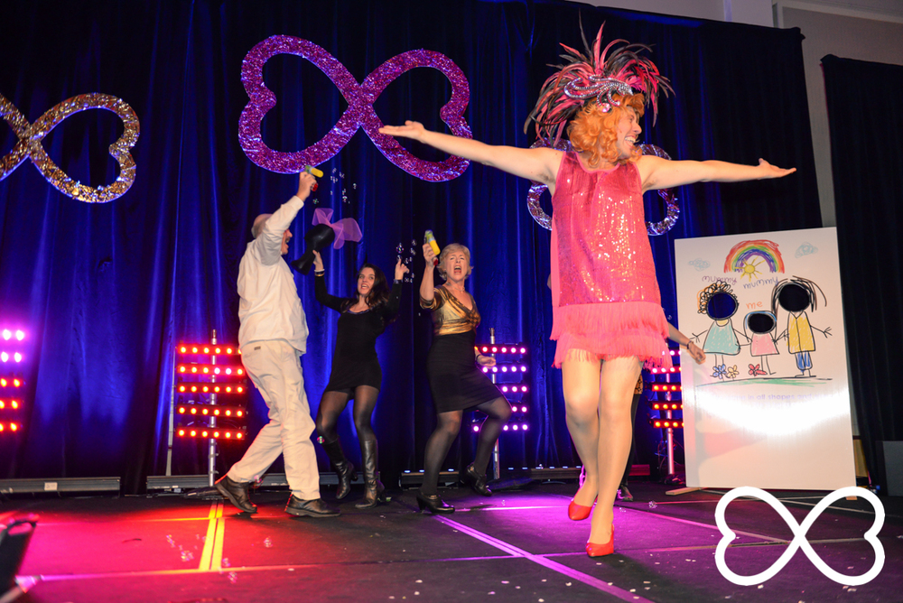 James Brechney performs with his family during Lip-Sync Duels.   Photograph by Jeffrey Feng Photography for SGLMG.
