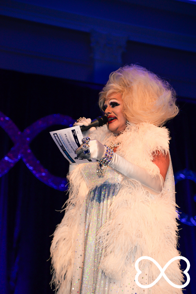Polly Petrie introduces Round 3 at Lip-Sync Duels.  Photograph by Jeffrey Feng Photography for SGLMG.