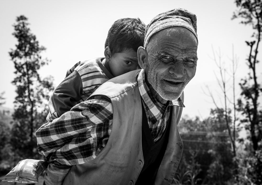 A grandfather reassures his grandson - Pokhara, Nepal.