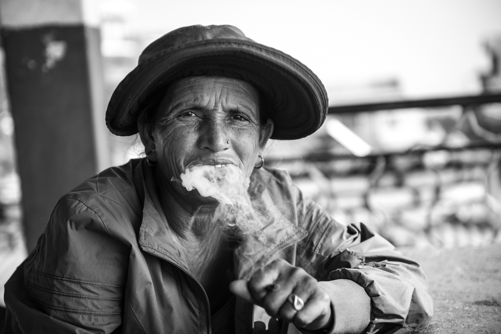 A lady who owns her own hotel enjoys an afternoon smoke - Pokhara, Nepal.