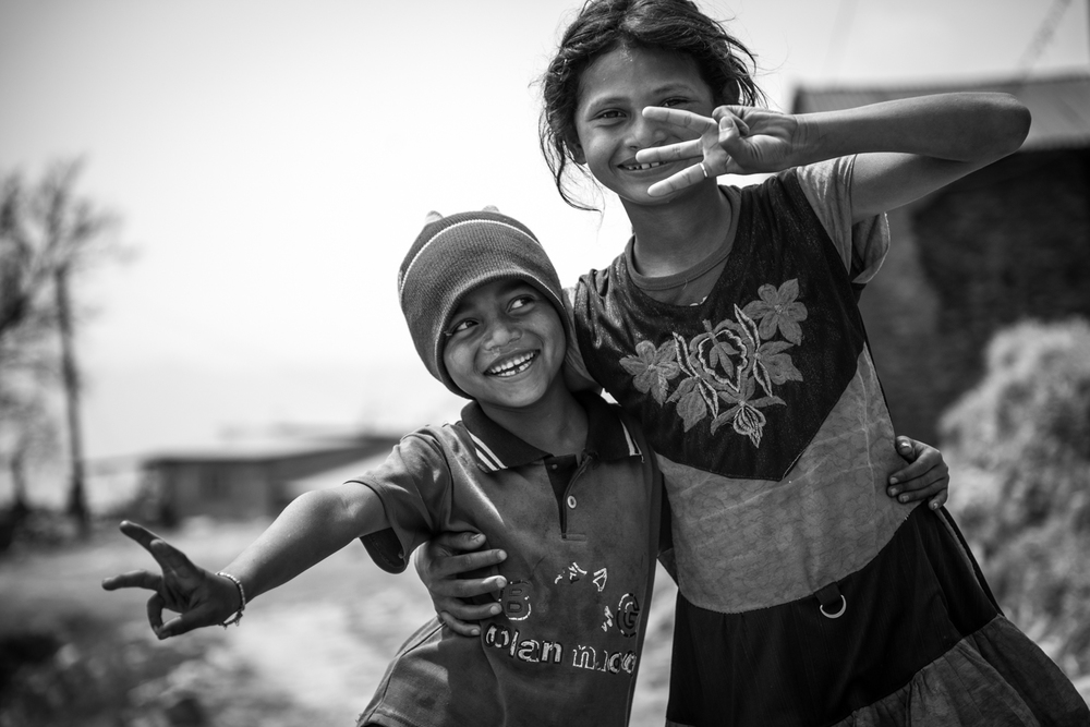 A boy and his sister play together - Pokhara, Nepal.