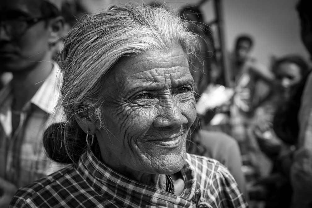 We receive a warm greeting from an elderly woman - Sindhupalchok, Nepal.