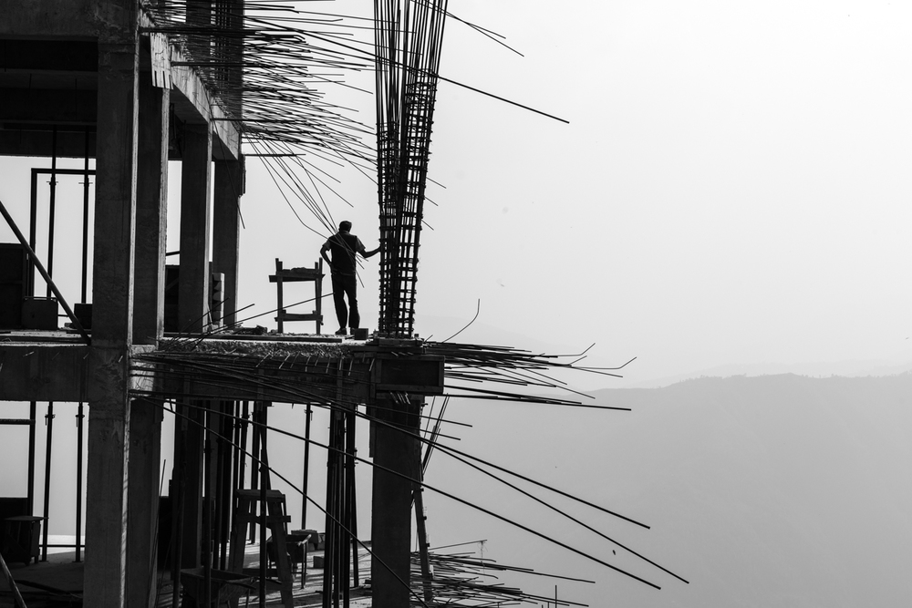 A man takes a break working on a construction site - Pokhara, Nepal.