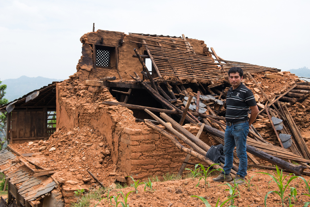 Prem, a business man that we met by chance when we had rented out one of his trucks to bring supplies to another village, stands in front of his destroyed house in Khari - a small village five hours high tucked away in the mountains of Nepal.